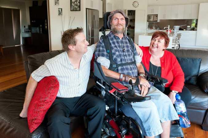 Jason Goodson, Slater & Goodson, Alan McCabe and Heather McKinnon, Slater & Gordon are raising funds for Spinal Cord Injury awerness. Photo: Rob Wright / The Coffs Coast Advocate