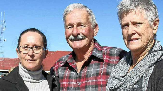 HIGH POINT: Mudgee couple Phil and Ann Grant, in Warwick to visit their daughter, Tracie Thomson, check out what was on offer at the pig and calf sale last week.