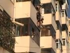 A couple were left dangling from a balcony in China after an argument.