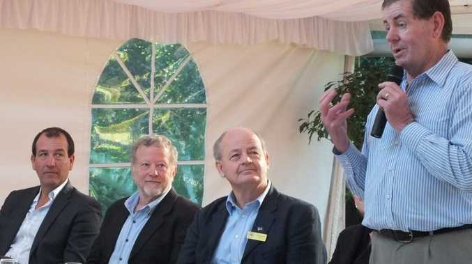 Peter Slipper addresses a breakfast meeting at Maleny as LNP's Mal Brough, the Greens' Garry Calridge and Palmer United Party's Bill Schoch look on.