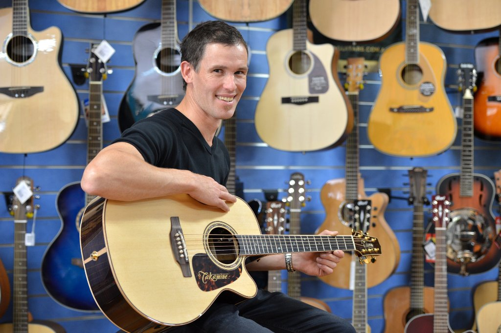 Michael Conroy with the prized Pro Series 7 Takamine acoustic electric guitar.