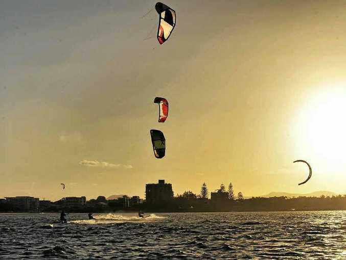 Kite surfers enjoy windy conditions at Bulcock Beach, Caloundra.