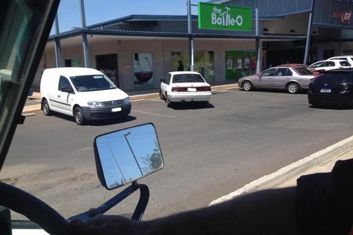 A motorist struggles to park between the white lines at the IGA shopping centre on Bridge St.