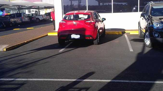 One parking space is not enough for this vehicle at Toowoomba Kmart Plaza.