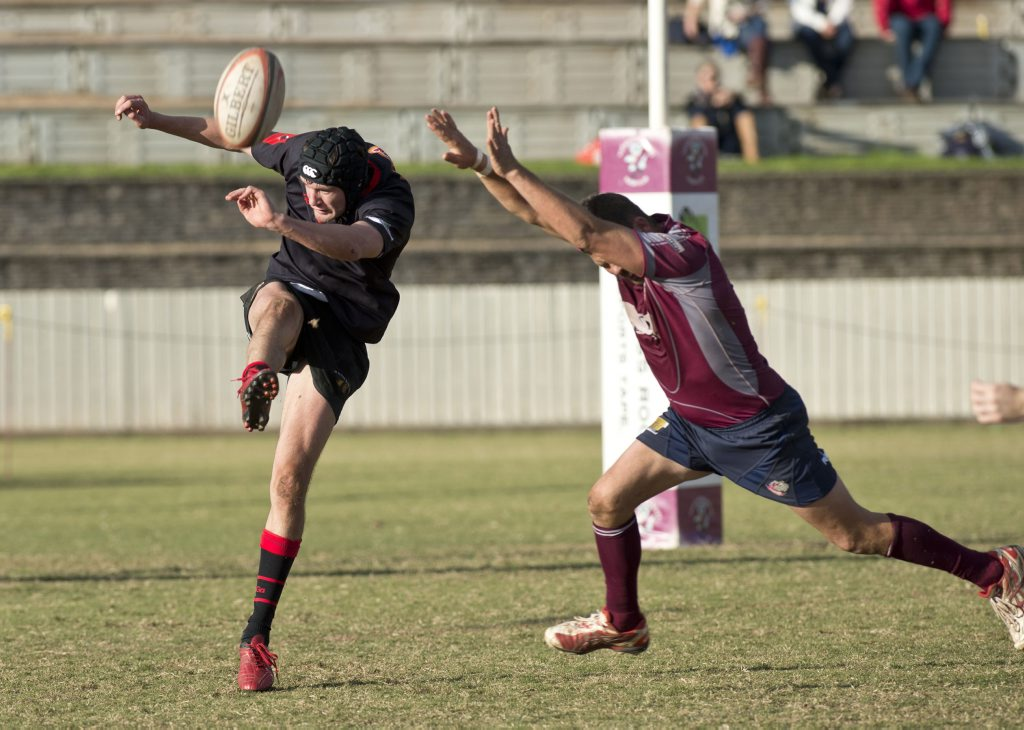Paul Maguire gets a clearing kick away for the Black Pigs against Toowoomba Bears in their round 16 Risdon Cup match.