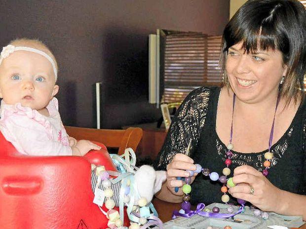 INSPIRATION: Mumtrepreneur Carly Mill with her seven-month-old apprentice, Scarlett. PHOTO: GEORJA RYAN