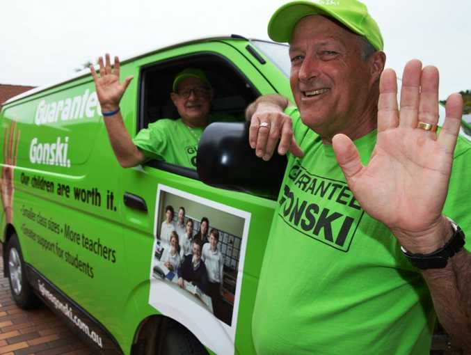 HANDS UP FOR GONSKI: Frank Barnes and Mike Trotter cruise around Grafton in their green Gonski gear, telling people just what Gonski means for our schools.