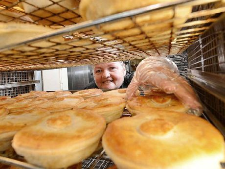 YUM: Old Fernvale Bakery worker Christine Begg at the bakery where they now sell a yowie pie, which contains game animals that the mythical creature would consider eating.