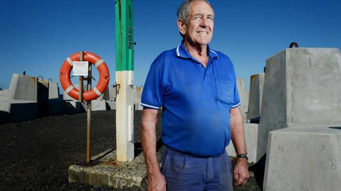 Geoff Muir of Ballina on the Ballina breakwall with the lifebuoy he used to help save two swimmers in distress.