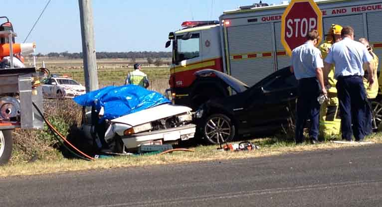 A woman has been killed in this two-vehicle crash west of Toowoomba.