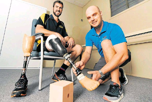 Dewet Heyns gets Marc Burton's prosthetic leg ready for this weekend's Tough Mudder.