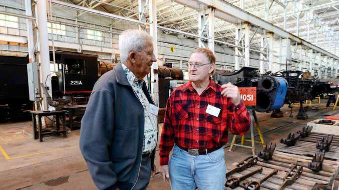 FOND MEMORIES: Former QR employees Neil Linnehan and Don Pryde, who worked together on the Blue Baby restoration, catch up at the rail reunion.