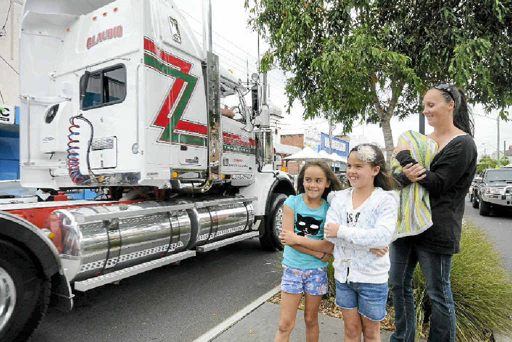CLOSE ENCOUNTER: Kalani, 6, Xailyn, 8, and mum Till Ellis all of Casino checking out the truck cavalcade down Centre Street at the Casino Truck Show on Saturday.