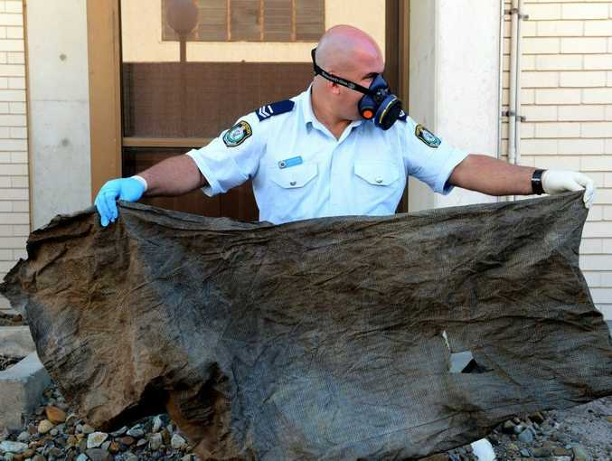 Senior Constable Luke Pryke at the Tweed police station with the bag the man was found in.