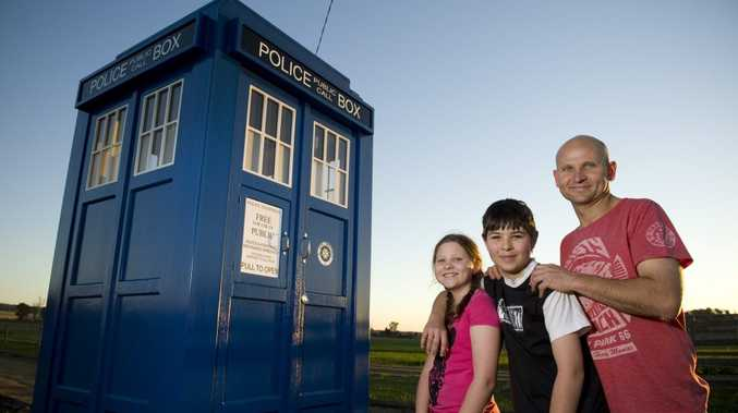 Mark Anderson and his kids Casey and Logan with the Dr Who TARDIS he built for them, Tuesday, August 13, 2013. Photo Kevin Farmer / The Chronicle