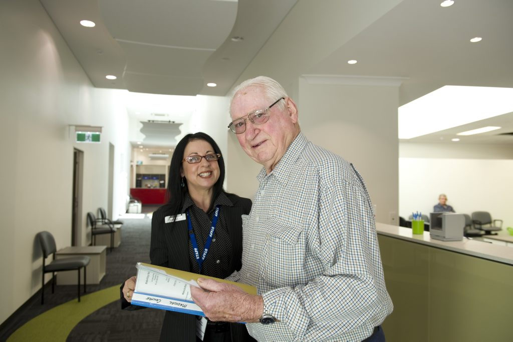 7 Springs Health + Dental employee Chris Beggs (left) with Ian Walker who was one of the first patients through the door.