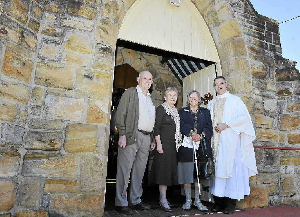 CENTENARY: Frank Slode, Nancy West and Lexie Pratt with the Venerable Lee Shirvill, Rector of the Parish of Alstonville, celebrating the 100th anniversary of the laying of the foundation stone at St Bartholomew's Church at Alstonville.