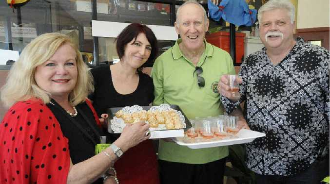 TUCKING IN: Enjoying some canapés from Dunes on Shelly Michelle Siwicki from Brunswick Heads, Lea Crawford, serving, from Dunes on Shelly, Shane Cullinane from Rotary Ballina and Russell Siwicki from Brunswick Heads enjoy the fine food and wine at the Ballina Fine Wine, Fun and Food Affair yesterday.