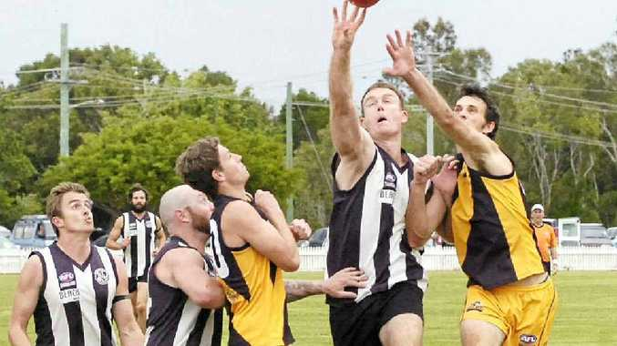 TALL ORDER: Byron Magpies ruckman Luke Henschke gets his fingers to the ahead of his Tweed Coast counterpart in the grand final at Ballina's Fripp Oval.