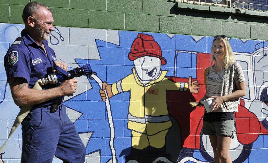 SAFER FOR KIDS: Captain Gregg Miller and artist Narani Henson with the mural.