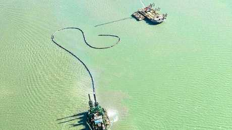 RAW DEAL: Aerial view of the Al Mahaar dredging in the Gladstone harbour.