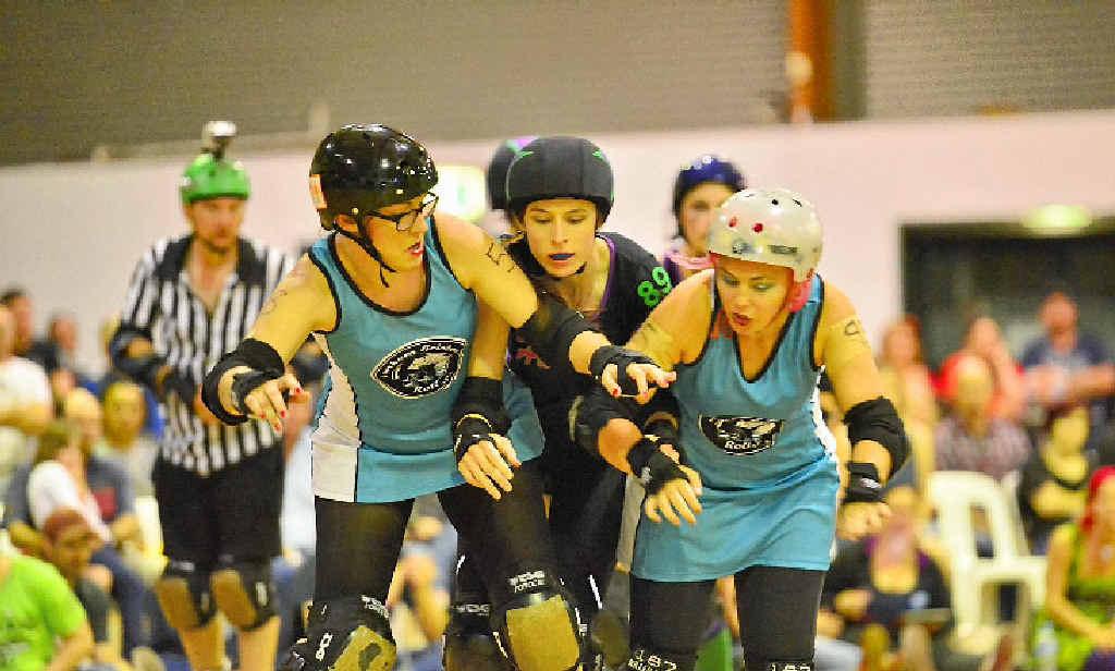 DERBY ACTION: The Harbour City Hustlers versus Townsville Roller Derby Super Villains Roller Derby bout.