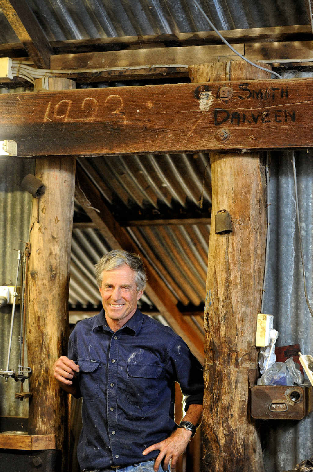 TRADITIONALIST: Gordon Smith stands proudly under the Oregon timber doorway in the shearing shed.