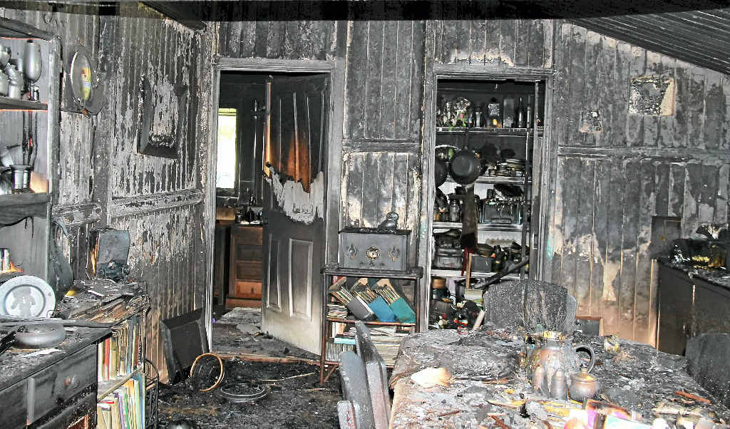 DESTROYED: The dinning room was one of the worst-affected rooms of the Warner St home after the fire broke out under the house in the early hours of Saturday morning.