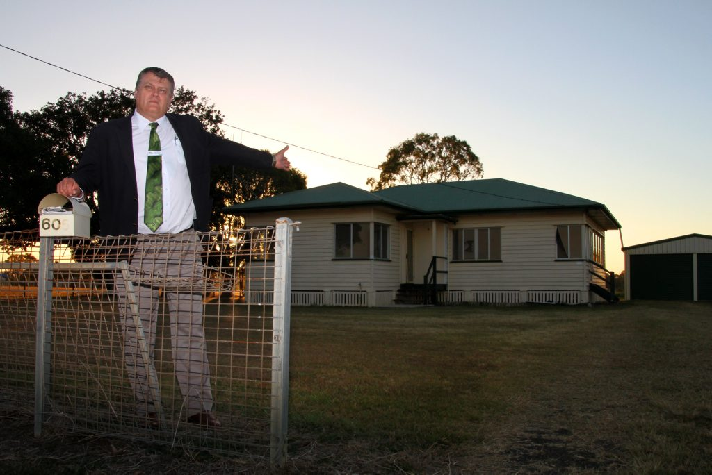 DAMAGED HOUSE: Bundaberg Regional Council councillor Wayne Honor votes against the disposal of the council owned house. Photo: Zach Hogg / NewsMail
