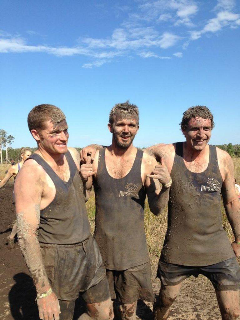 Dan Smith, Gary McIntyre and Josh Arnold get muddy at Tough Mudders on the Sunshine Coast.