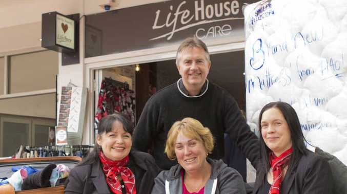 HELPING HANDS: Julie Alderman (centre) with Pastor Tony Peter from Lifehouse Care and Alison and Alina from PRD Realty. INSET: The fire which destroyed most of Julie's possessions earlier this month.