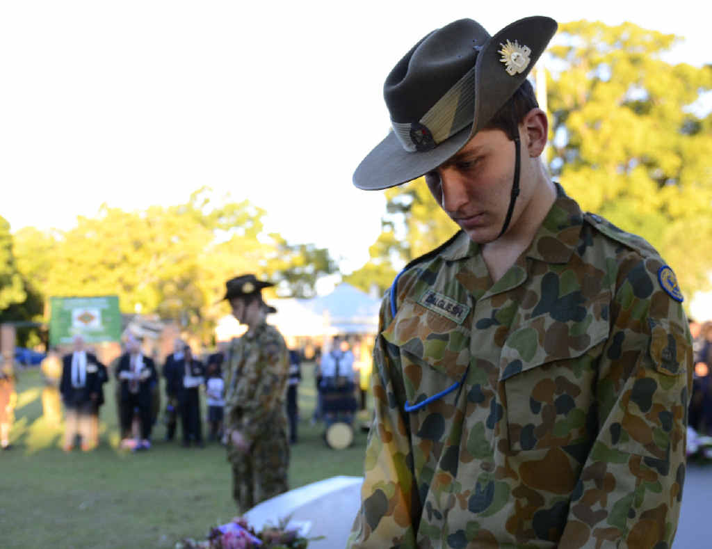 STANDING GUARD: Soldiers at the cenotaph for the Vietnam Veterans Day commemoration at Memorial Park, Grafton on Sunday.