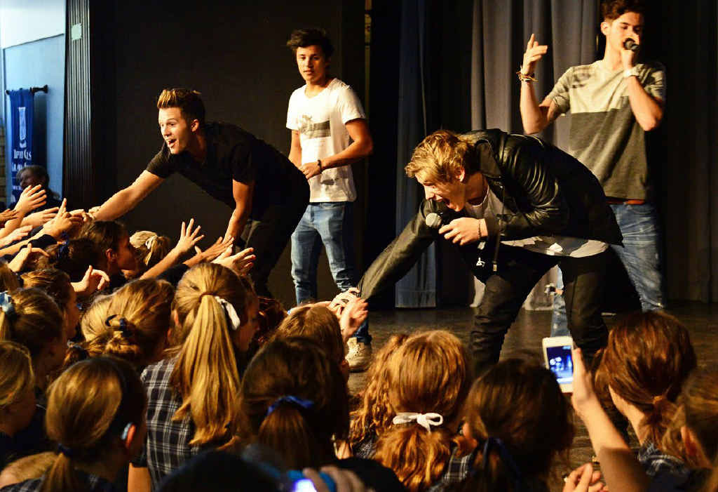 FRENZIED CRUSH: X Factor contestants What About Tonight performed for excited Ipswich Girls Grammar School students during lunch break yesterday.