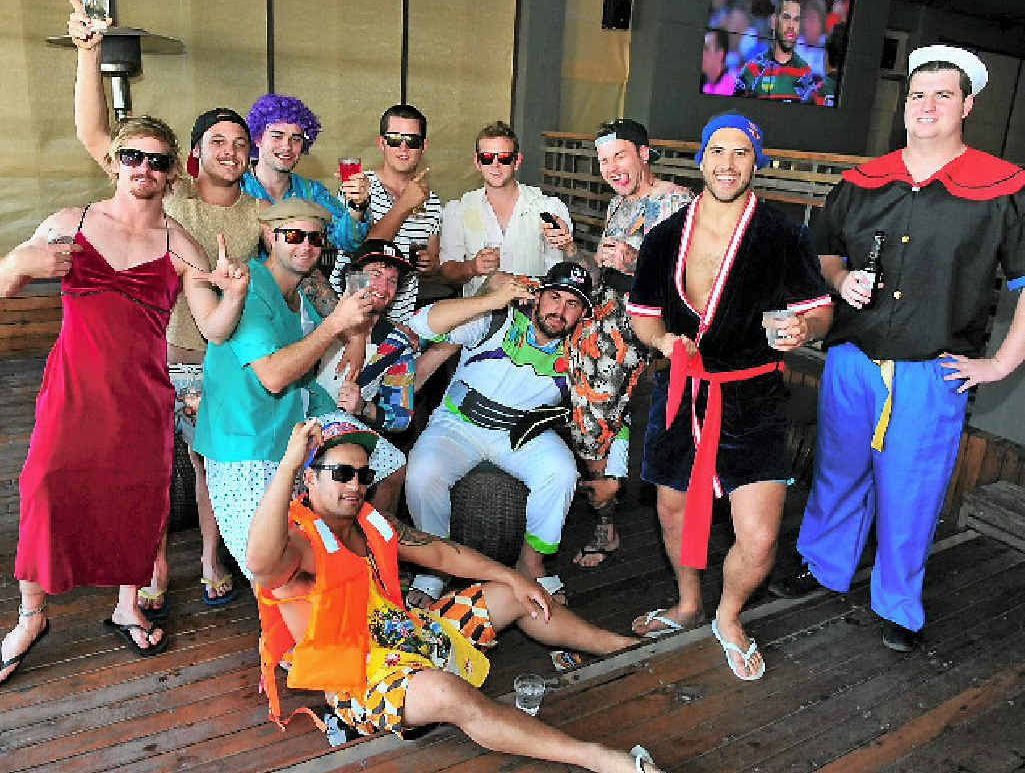 FROCKS AND JOCKS: The Brothers rugby league team celebrated Mad Monday at the Reef Hotel.