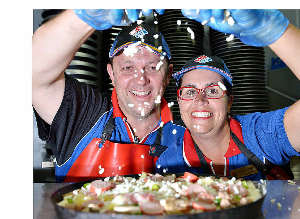 ON TOP: David and Melissa Burness at their Domino's Noosa pizza store.