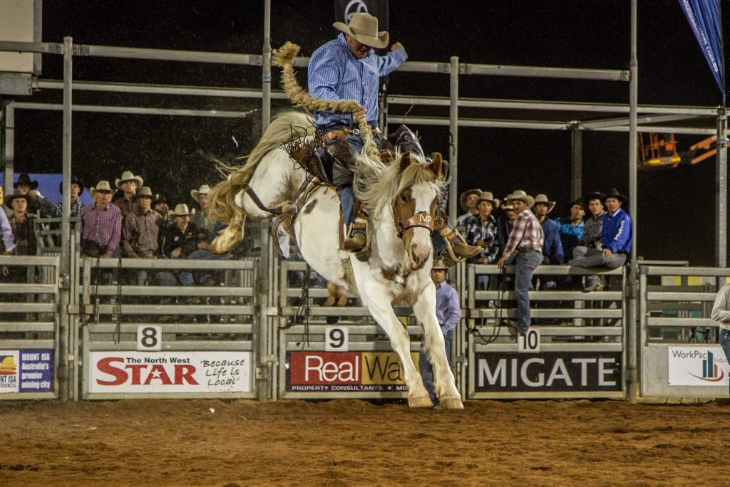 Saddle bronc riding at the Mount Isa Mines Rotary Rodeo. Credit: Ben MacRae