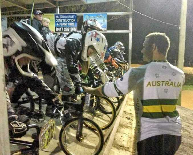 HELPING HAND: BMX champion Chris Poole passes on some tips at the start gates at last weekend's Clarence Valley BMX Club meeting at South Grafton.