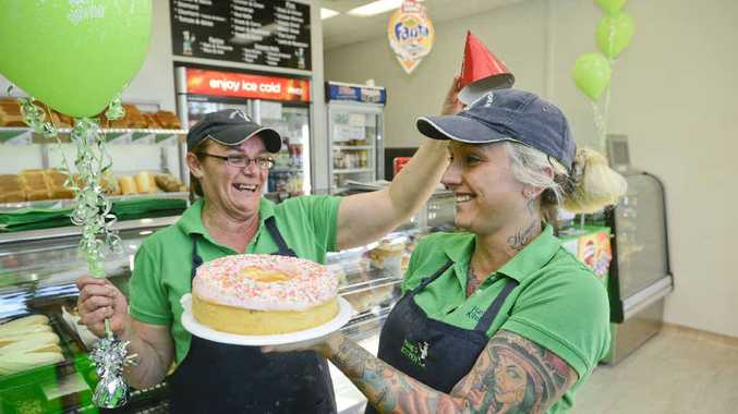 PARTY TIME: Sharon Lentfer and Meagan Martin get into the birthday spirit at the South Grafton Hanks as it prepares for its first birthday.