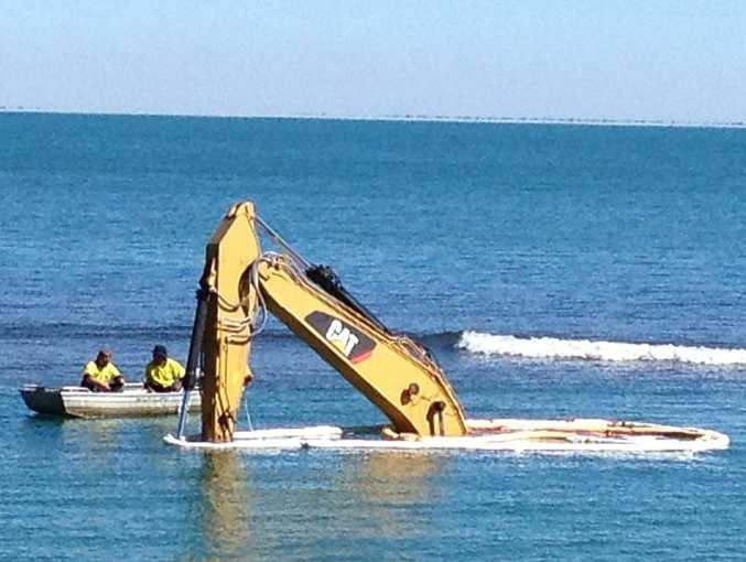 The excavator at Gatakers Bay is underwater on Wednesday morning.