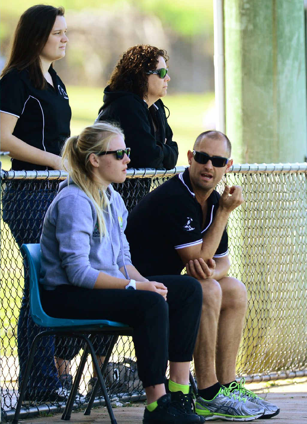 VITAL SUPPORT: Wests player Eden Jackat (sitting) joins supportive coach Steve Rogers in cheering on the A-grade team following her knee reconstruction.