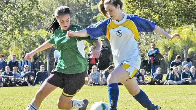 ON THE BALL: Trinity Catholic College Lismore's Lulu Herchenroder (right) challenges Hunter Sports High defender Zoe Jones during the Bill Turner Trophy clash.