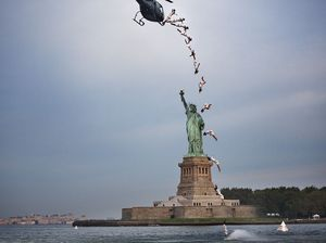 Diver jumps out of helicopter in front of Statue of Liberty