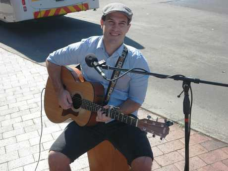 Acoustic music out the front of Toast in Grafton was being supplied by Ryan Martin.