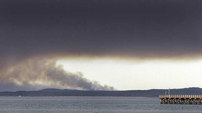 A large plume of smoke billowing from the northern tip of Fraser Island has been caused by Queensland Parks and Wildlife Service rangers.