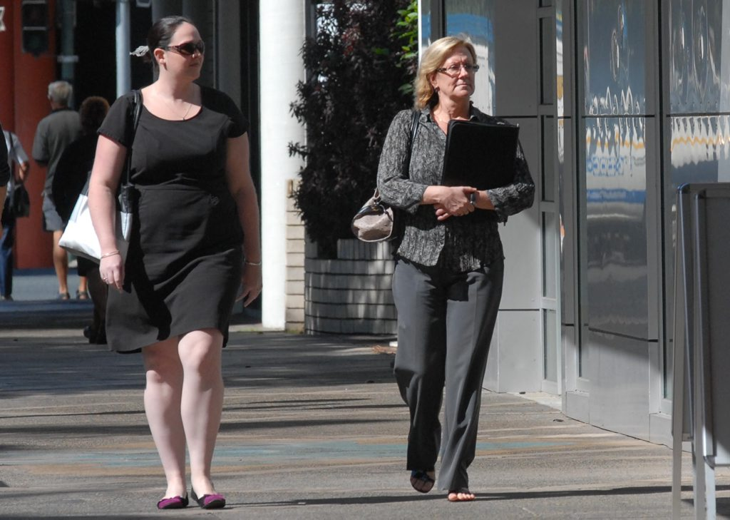 BRI Ferrier Townsville principal Moira Carter (right) and Meagan Barry walking towards Mackay Telegraph office.