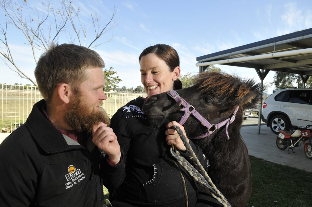 Dale Groves and Kristy Banks with Gordie the horse, which they purchased for their un-born son. Dale grew a beard to raise funds for Spinal Cure Australia.