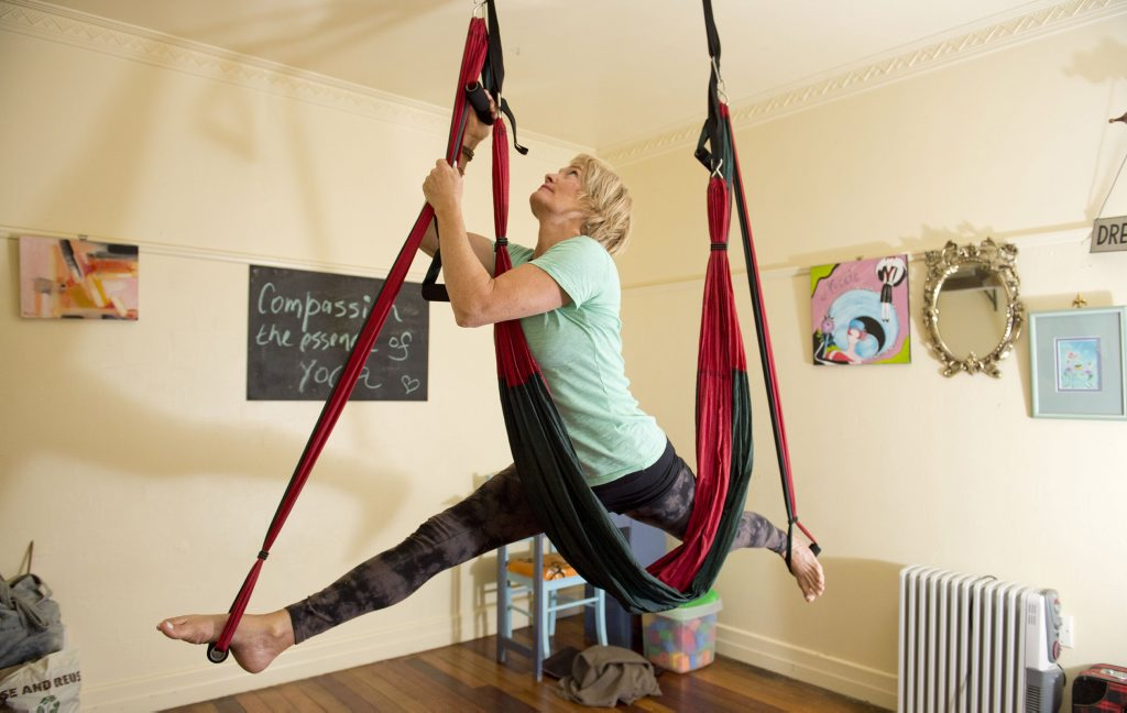 Zama Yoga Toowoomba instructor Deb Goulding defies gravity as she practises aerial yoga. Deb says the new form of fitness helps with flexibility and joint stress but is more importantly fun.