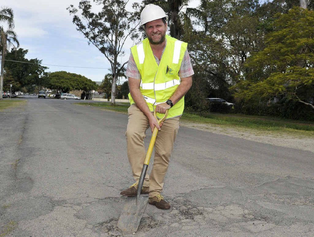 Byron Shire Mayor Simon Richardson is getting on with the job of repairing potholes around the shire. A smart phone app is available to let the council know where the potholes are.