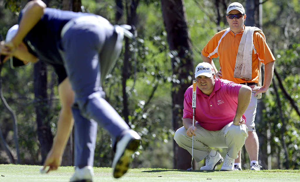 TOUGH GOING: Ipswich golfer Adam Gemmell lines up his shot at the second hole during the first round of the Queensland Open at Brookwater Golf and Country Club. Gemmell carded 10 over.