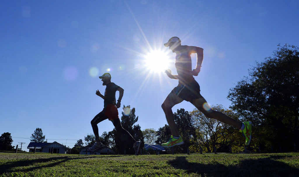 DEDICATED DUO: Experienced Ipswich athletes Peter Reeves and Paul Shard hope to shine at tomorrow's Ipswich Winter Carnival at Bill Paterson Oval. Reeves has been coaching Shard to major masters competition success in recent months.